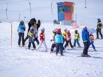 Ski instructors study young skiers. Ski resort in Alps, Austria, Zams on 22 Feb 2015 Stock Photography