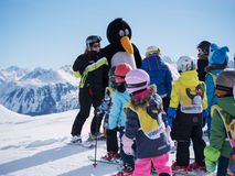 Ski instructors study young skiers. Ski resort in Austria, Zams on 22 Feb 2015. Skiing, winter season, mountains. Ski instructors study young skiers in children Royalty Free Stock Photography