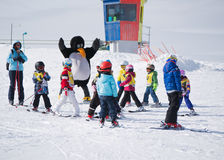 Ski instructors study young skiers in ski school in Alps. Ski re Stock Images