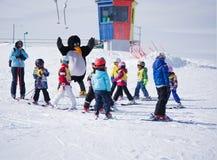 Ski instructors study young skiers in ski school in Alps. Ski resort in Austria, Zams on 22 Feb 2015 Royalty Free Stock Photo