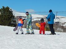 Ski instructors  with their young  pupils. Stock Photos