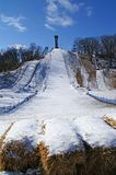 Ski Jump. In the winter, steep hill, snow and a buffer of straw packs Royalty Free Stock Photography