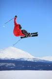 Ski jump. Young skier who jump high up in the air Royalty Free Stock Images
