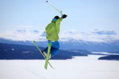Ski jump. Young skier who jump high up in the air Stock Photos