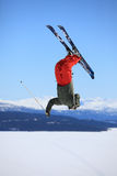 Ski jump. Teenage skier who jump high up in the air Royalty Free Stock Images