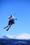 Ski jump. Teenage skier who jump high up in the air Stock Photography