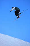 Ski jump. Teenage skier who jump high up in the air Stock Photos