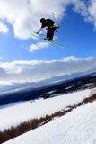 Ski jump. Skier who jump high in the air Royalty Free Stock Photos