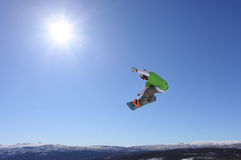 Ski jump. Skier who jump high in the air Royalty Free Stock Images