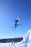 Ski jump. Young skier who jump high in the air Stock Photos