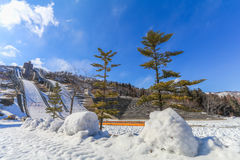 Ski jump area or ski springboards against with snow on the mount. Ain and blue sky and clouds background in Hakuba  Nagano Japan Stock Photos