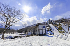 Ski jump area or ski springboards against with snow on the mount. Ain and blue sky and clouds background in Hakuba  Nagano Japan Stock Photography