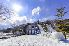 Ski jump area or ski springboards against with snow on the mount. Ain and blue sky and clouds background in Hakuba  Nagano Japan Royalty Free Stock Images