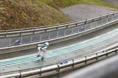 Ski jump. Artificial track. Winter sport. Norwegian summer. Horizontal Royalty Free Stock Photos