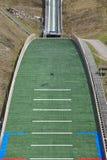 Ski jump. Artificial track. Winter sport. Norwegian summer. Royalty Free Stock Photography