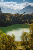 Ski jump with forest, lake and mountains. In fall Royalty Free Stock Image