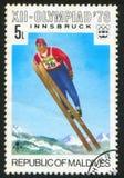 Ski jump. MALDIVE ISLANDS CIRCA 1976: stamp printed by Maldive Islands, shows Ski jump, circa 1976 Royalty Free Stock Photos