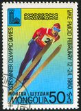 Ski jump. MONGOLIA - CIRCA 1980 stamp printed by Mongolia, shows Lake Placid 80 Emblem, Ski jump, circa 1980 Stock Photography
