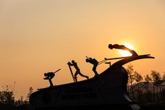 Ski jump pyeongchang the winter olympics travel. Evening fin; freedom jump orange people silhouette sun  sunset Royalty Free Stock Photo