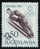 Ski jump. RUSSIA KALININGRAD, 12 NOVEMBER 2016: stamp printed by Yugoslavia, shows ski jump, circa 1968 Stock Images