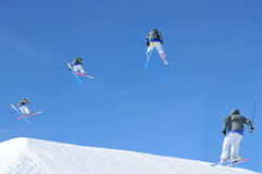 Ski jump sequence. Sequence of a skier making a jump. In chronological order from left to right. Initially he crosses his skis and starts a turn. In the second Royalty Free Stock Photography