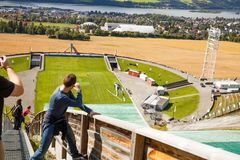 Ski jump slope in Lillehammer. Norway-August 21, 2014 -  The skier jumping at the Ski jump slope Lysgardsbakken, opened in 1993, specifically to the XVII Olympic Royalty Free Stock Images