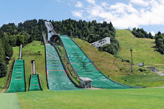 Ski jump slope in summer. A sunny picture of the ski jump slopes in Garmisch-Partenkirchen (Germany) in summertime stock photos