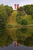 Ski-jump tower. Ski-jump tower in summer reflecting in lake stock photos