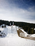 Ski jump tower at mountain Stock Images