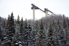 Ski jump towers at Lake Placid Olympic village. Ski jump towers against the pine forest Royalty Free Stock Image