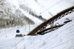 The ski-jump in winter mountains Royalty Free Stock Images
