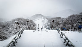 Ski jump in winter. Sapporo, Japan - March 11, 2015: Ski jump and snowy landscape from the viewing platform at Okurayama, home of the Winter Olympics in 1972 Stock Images