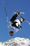 Ski Jumper. A freestyle ski jumper inverted revealing his shorts Stock Photo