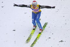 Ski jumper Simon Ammann lands. ENGELBERG - DECEMBER 19: Ski jumper Simon Ammann lands safely at FIS World Cup December 19, 2009 in Engelberg SUI. He ended Stock Photo