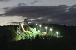 Ski jumping hills in night-time lighting Royalty Free Stock Photos