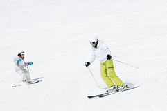 Ski lesson. Mother with daughter on ski Royalty Free Stock Images