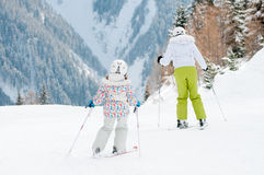 Ski lesson. Mother with daughter on ski Royalty Free Stock Photography