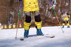 Ski Lesson. New skier practicing ski at the ski resort.  The others at the back practice in group Royalty Free Stock Image