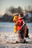 Ski lesson. Mother coaching her young daughter downhill skiing Stock Images
