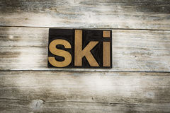Ski Letterpress Word on Wooden Background Royalty Free Stock Photography