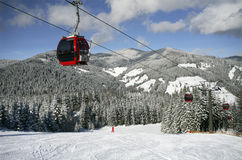Ski lift. S with austrian mountains and snow covered fir trees Stock Photography