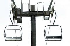 Ski Lift. A black ski lift isolated against a white background stock photo