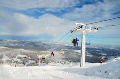 Ski lift. Panorama on a sunny day with some clouds Royalty Free Stock Image