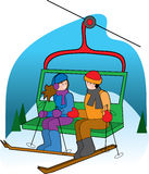 Ski Lift. A couple on a ski lift talking to each other Stock Photo