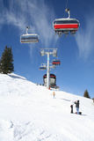 Ski Lift. A ski lift carries skiers up a mountain stock photography