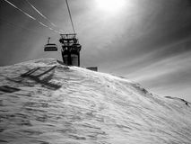 Ski lift. Silhouette on snow covered mountain Stock Images