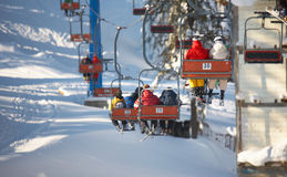 Ski lift. The Ski lift carrying skiers Stock Images