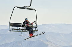 Ski lift. Skier on ski lift at resort in Siberia Royalty Free Stock Photography