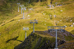 Ski lift. Seen alog the Eiger Trail, a hiking trail in the Bernese Alps Switzerland Royalty Free Stock Image