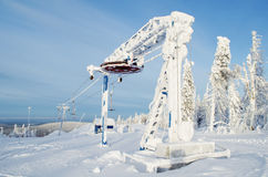 Ski lift. Covered with snow on a Mountain  in a bright sunny day Stock Photography